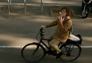 Image of smoker on a bicycle