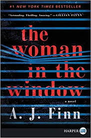 Woman in the window cover image