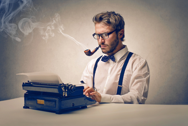 image of man at typewrite smoking a pipe