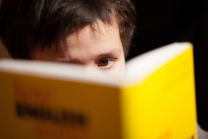 image of a boy reading a book